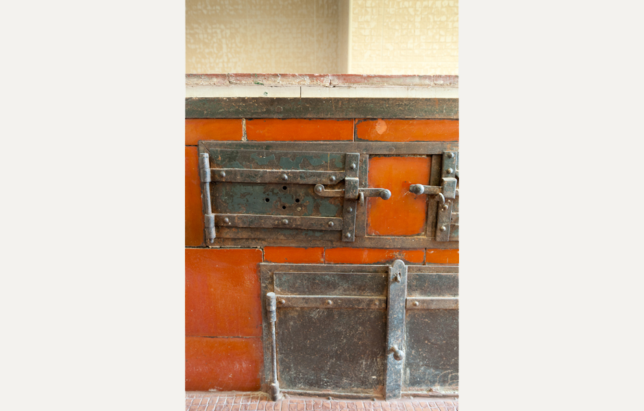 Original details, like this wood stove, provide character