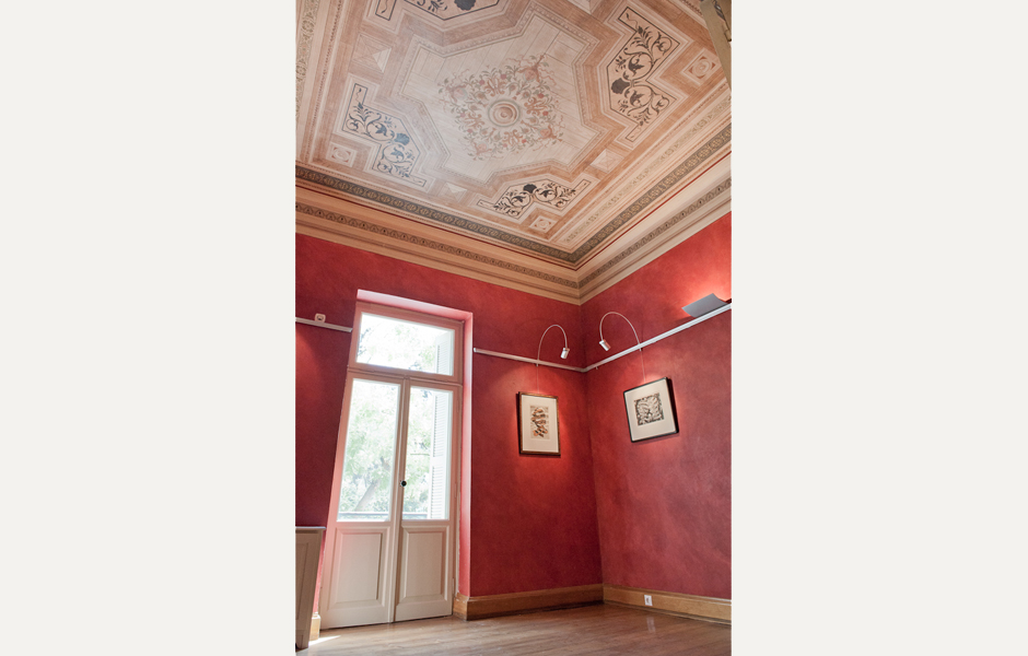 Each room is unique, with richly colored walls and restored ceiling paintings
