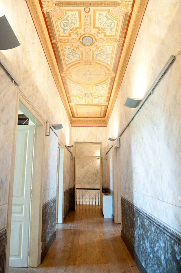 The second floor corridor is also features restored hand painted walls and ceilings
